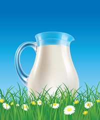 fresh milk jug on grass field with chamomile