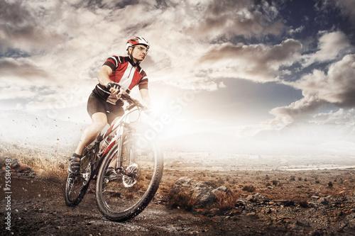 Mountain Bike cyclist riding single track - 75584958