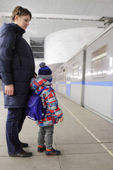 Mother with son on subway platform