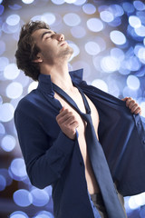Handsome sexy man in shirt on bright background