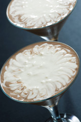 two-layer chocolate dessert in glasses, close-up