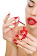Manicure process – Beautiful women with stylish make-up, red lip