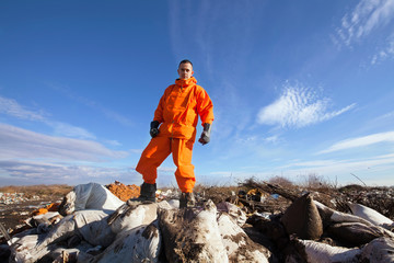 Man standing at the top of the garbage