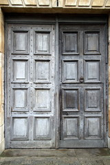 A pair of old wooden doors at an entrance