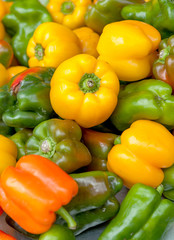 Green, yellow and orange peppers