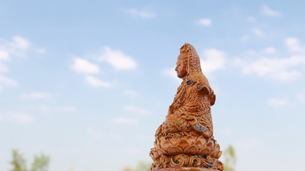 Guanyin statue with blue sky