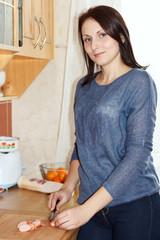 Food Preparation - Woman cutting sausage