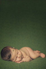 Dreaming and Sleeping Naked Newborn Baby