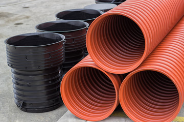 Close up of stack of underground plastic pipes