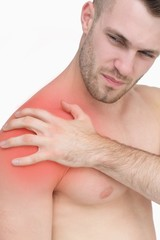 Closeup of shirtless man with shoulder pain