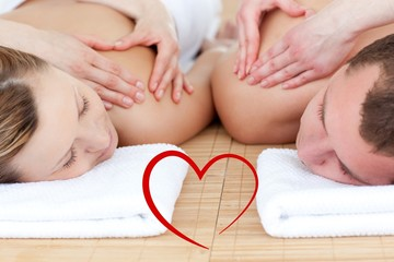 Composite image of young couple receiving a back massage