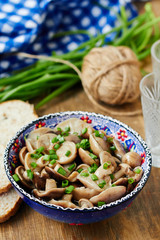 Marinated mushrooms in a blue bowl