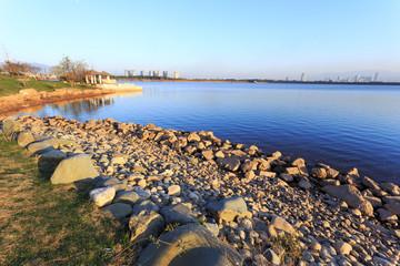skyline and lake near resort in suburb.