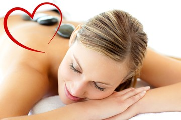 Composite image of pretty woman having a massage