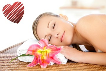 Composite image of portrait of a cute woman having a massage