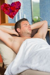 Composite image of man relaxing at the spa