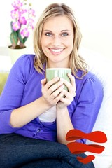 Blond woman enjoying her coffee sitting on the sofa