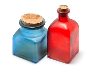 Bottles of colored glass on a white background