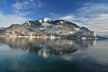 Austrian lakes in the winter, snow, mountain reflection