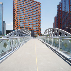 footbridge and office building in modern city