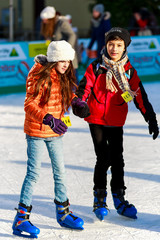a girl and a boy friend on the rink
