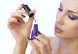 Makeup, beauty. manicure process - purple manicure