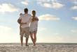 Leinwanddruck Bild - Happy Family On Beach Vacation Looking at Ocean