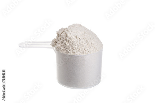 In de dag Zuivelproducten Measuring spoon for milk whey protein. On a white background.