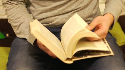 Flipping reading and leafing through a book