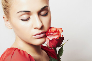 beautiful woman with red rose. beauty girl and flower.flowers