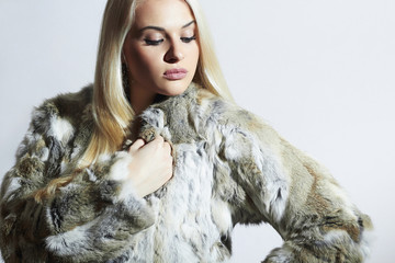 Beautiful woman in fur.winter fashion. blond Girl in Fur Coat