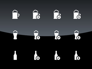 Bottle and glass of beer icons on black background.