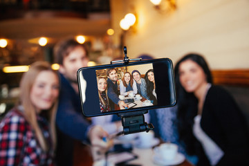 Group Of Friends In Cafe Taking Selfie