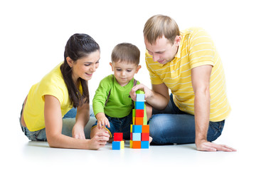 kid with his parents play building blocks