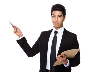 Businessman with clipboard and pen point up