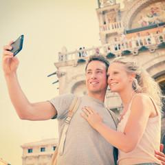 Selfie travel couple in love in Venice, Italy