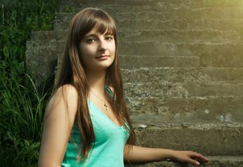 beautiful Christian girl sitting on stairs