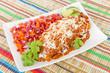 Chicken & Chorizo Enchiladas served with salsa.