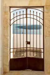 Private door with caldera view in Santorini, Greece