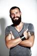Tattooed bearded man wearing gray t-shirt