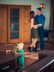 playful baby boy and happy parents at home
