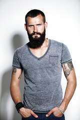 Tattooed bearded man wearing gray t-shirt