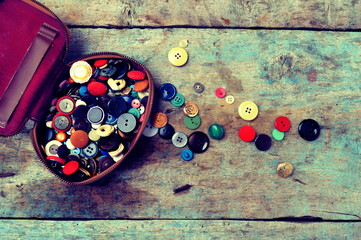 Old buttons on a wooden background