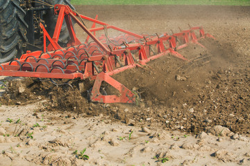 Close up shot of seedbed cultivator machine at work