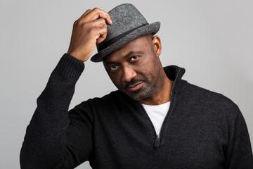 Black Unshaven Man Saluting With Hat