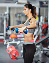 Girl doing deltoid workout