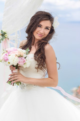 young bride in a wedding arch