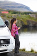 Travel woman by mobile motor home RV campervan - 75610125