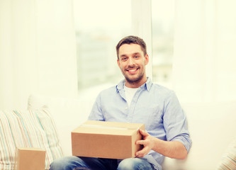 man with cardboard boxes at home