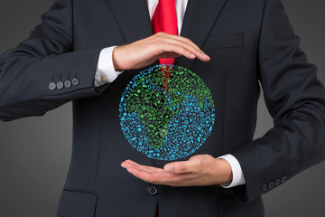 businessman holding media icon in form earth